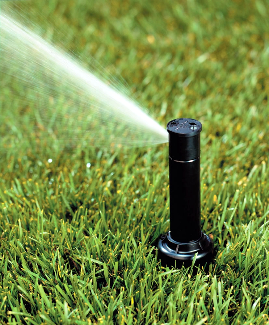 sprinkler spraying water in Alabama yard